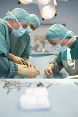 Physicians in Surgery operating on patient