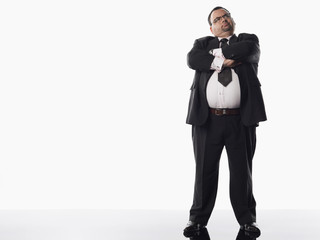 Overweight businessman with arms crossed
