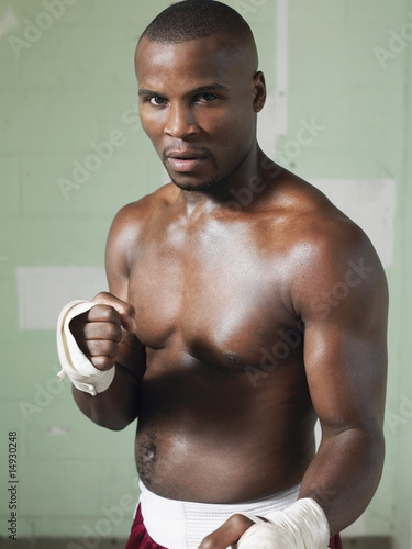 Boxer with raised fists, portrait