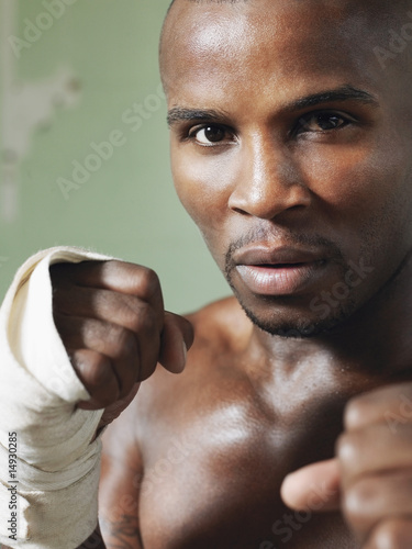 Boxer with raised fists, close-up