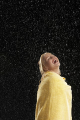 Laughing Woman Wrapped in Towel Standing in Rain