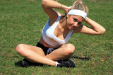 Lovely fitness girl exercising in nature