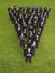 Large group of business people standing in triangle formation, clapping, elevated view