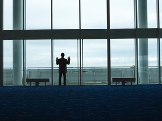 Businessman standing, Looking out Window, back view