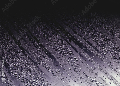 Water drops running through fog on Glass
