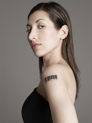 Young woman with bar code tattoo on her arm