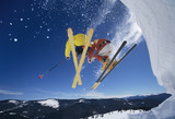 Skiers launching off snow bank, Hitting the Slopes, low angle view