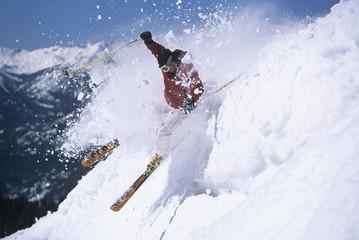Skier skiing through powdery snow on ski Slope