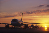 Planes Sitting on Tarmac at Sunset