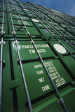 Green Shipping Containers stacked on one another