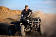 teenager riding quad ATV