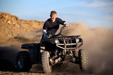 teenager riding quad ATV