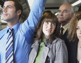 Female Commuter Standing by Man's Wet Armpit on Train