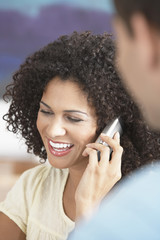 Businesswoman Using Cell Phone in Meeting