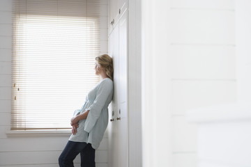 Woman Standing by Bathroom Window