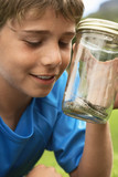 Boy Looking at Snake in Jar