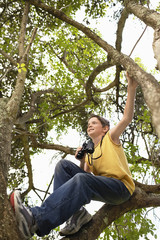 Boy in Tree Using Binoculars