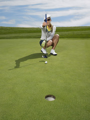Golfer lining up shot