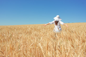 Happy girl in grain field