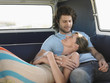 Affectionate Young Couple Relaxing in Camper Van