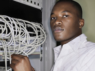 Man connecting network cables.