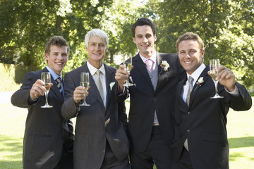 Four men toasting at wedding, portrait
