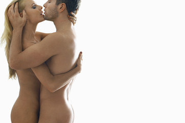 Naked couple embracing, on white background