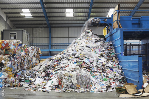 Waste coming out of machine in recycling factory