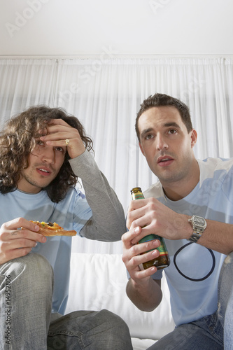 Two Anxious Men Watching Television