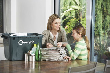 Woman and Girl Collecting Recyclables