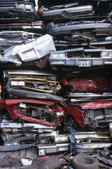 Pile of crushed cars in junkyard, full frame