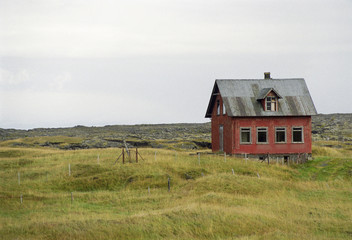 Old house in rugged landscape