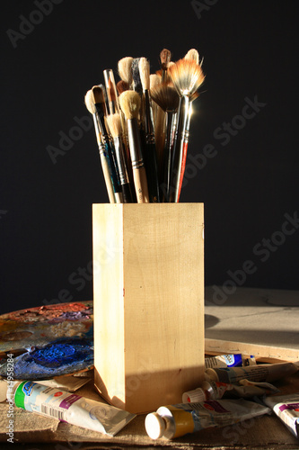 brushes for painting in a wooden glass  on a dark background