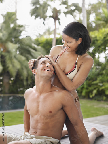 Affectionate Young Couple Relaxing on Patio