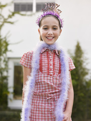 Portrait of girl 10-12 in tiara and feather boa