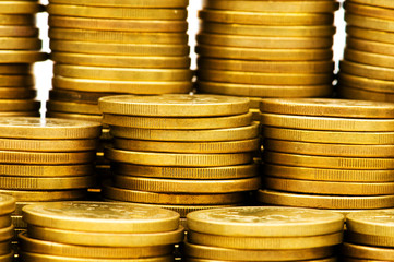 Close up of stack of gold coins