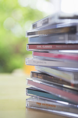 Pile of CD jewel cases on table, close-up