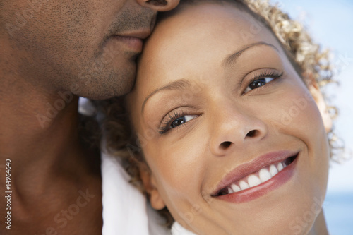 Man and woman embracing, close up of woman's face