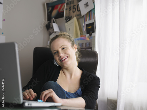 Woman using laptop sitting at office