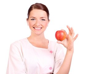 Nurse holding up an apple