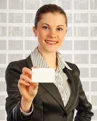 Attractive business woman with a business card