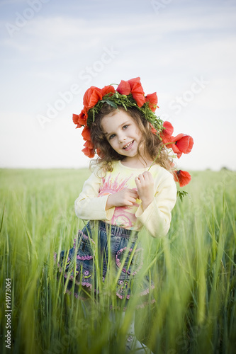 Smiling little girl in floral wreath
