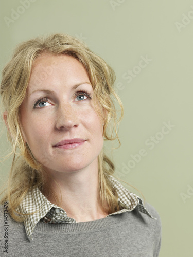 Mid adult woman looking up