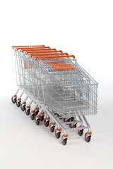 New unbranded shopping trollies on white background