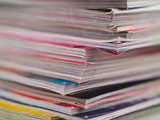 Magazines Unevenly Stacked Edge Focus poster
