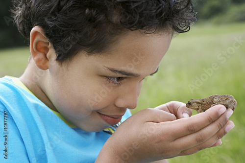 Boy 7-9 holding Toad, close-up
