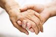 Leinwanddruck Bild - adult helping senior in hospital