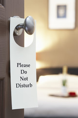 "Do Not Disturb"""" sign on hotel room's door"