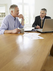 Senior man planning personal finance at home with finacial advisor