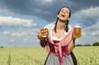 Lachende Frau mit Dirndl im Feld